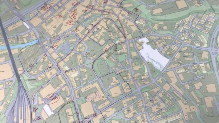 Printed map of Stockport with routes scribbled on it
