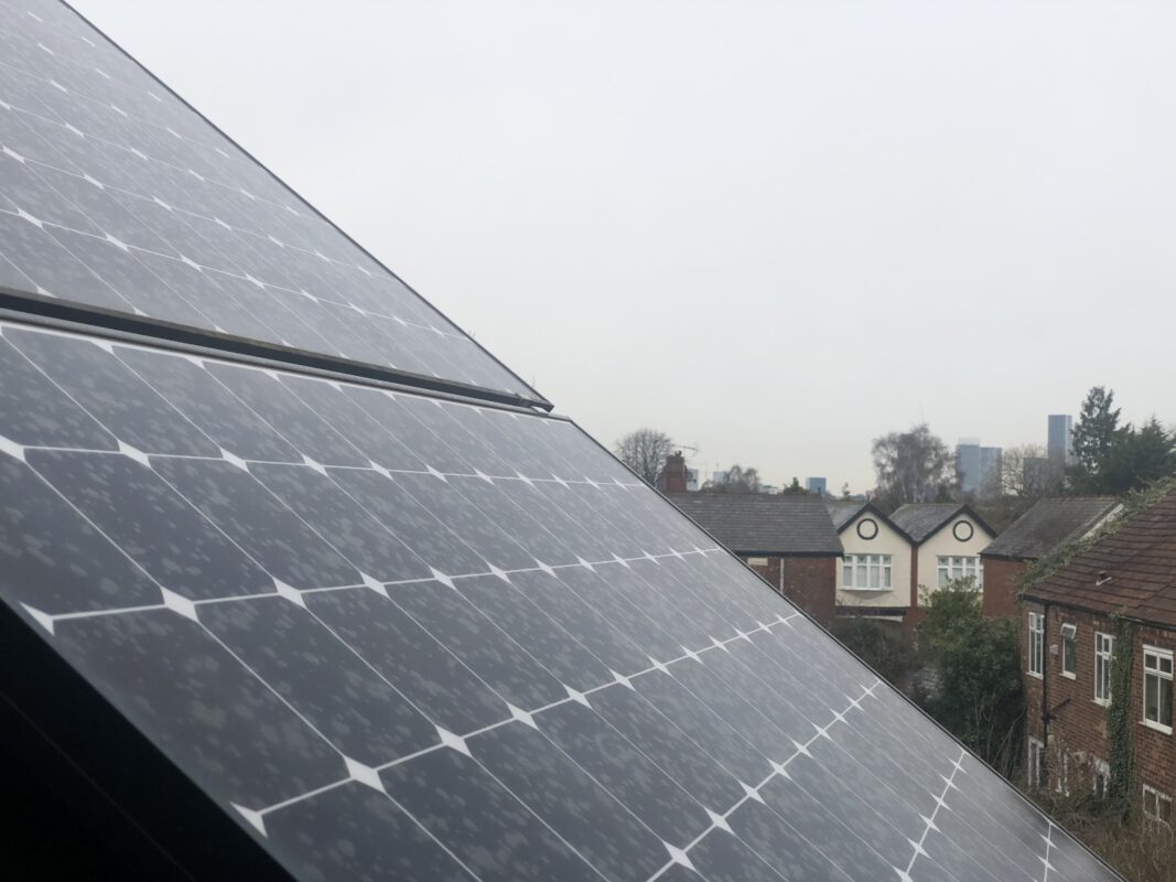 View of rooftop solar panel array looking towards Manchester