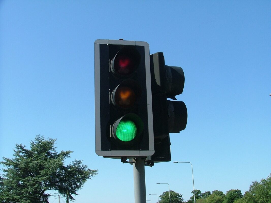 A photograph of a traffic light showing green for 'go'
