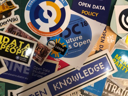 A photograph of a pile of different open-data stickers