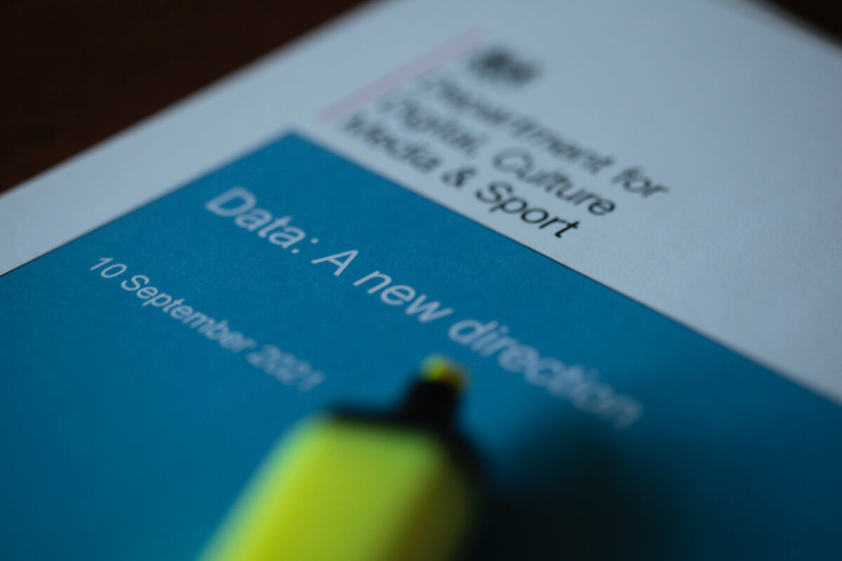 A photo of the Data: a new direction consultation document with a yellow highlighter pen resting on the cover